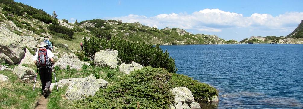 Photo of hikers at Popovo Ezero (Priest Lake) in the Pirin Mountains of Bulgaria
