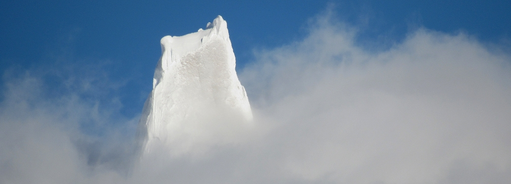 The summit of Cerro Torre peeking through the clouds, Patagonia, Argentina