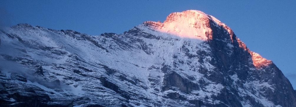 Sunrise lights the summit of the Eiger as seen from Grindelwald, Switzerland