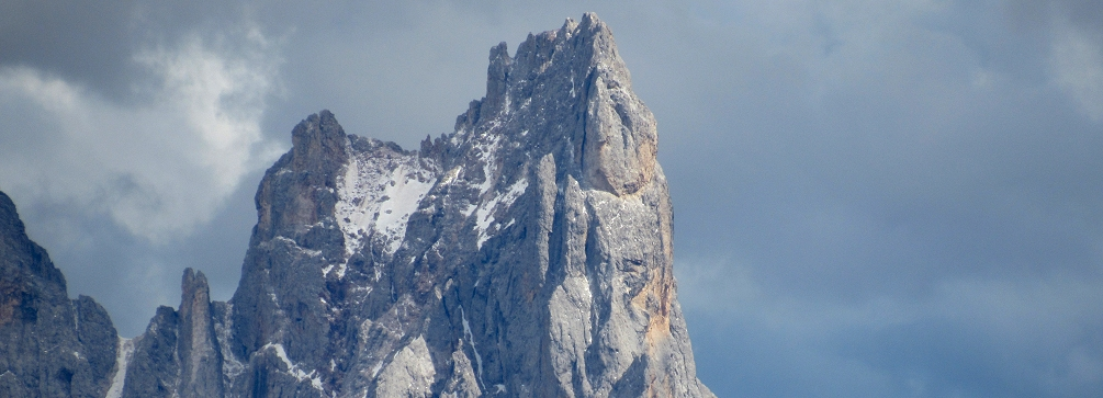 The Cimon della Pala rises above Passo Rolle in the Dolomites of Italy
