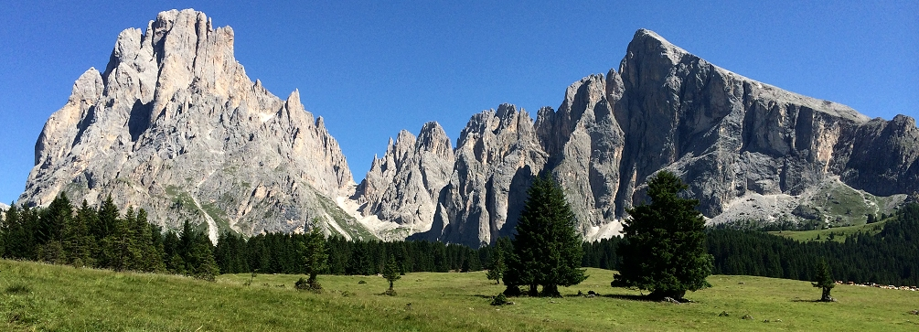The Sassolungo rises over the meadows of the Alpe di Siusi, Dolomites of Italy
